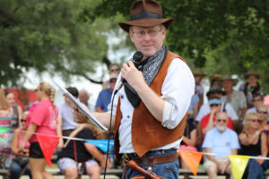 Gery MC's the Indiana Jones bullwhip fast draw competition at the Annie Oakley Festival in 2019